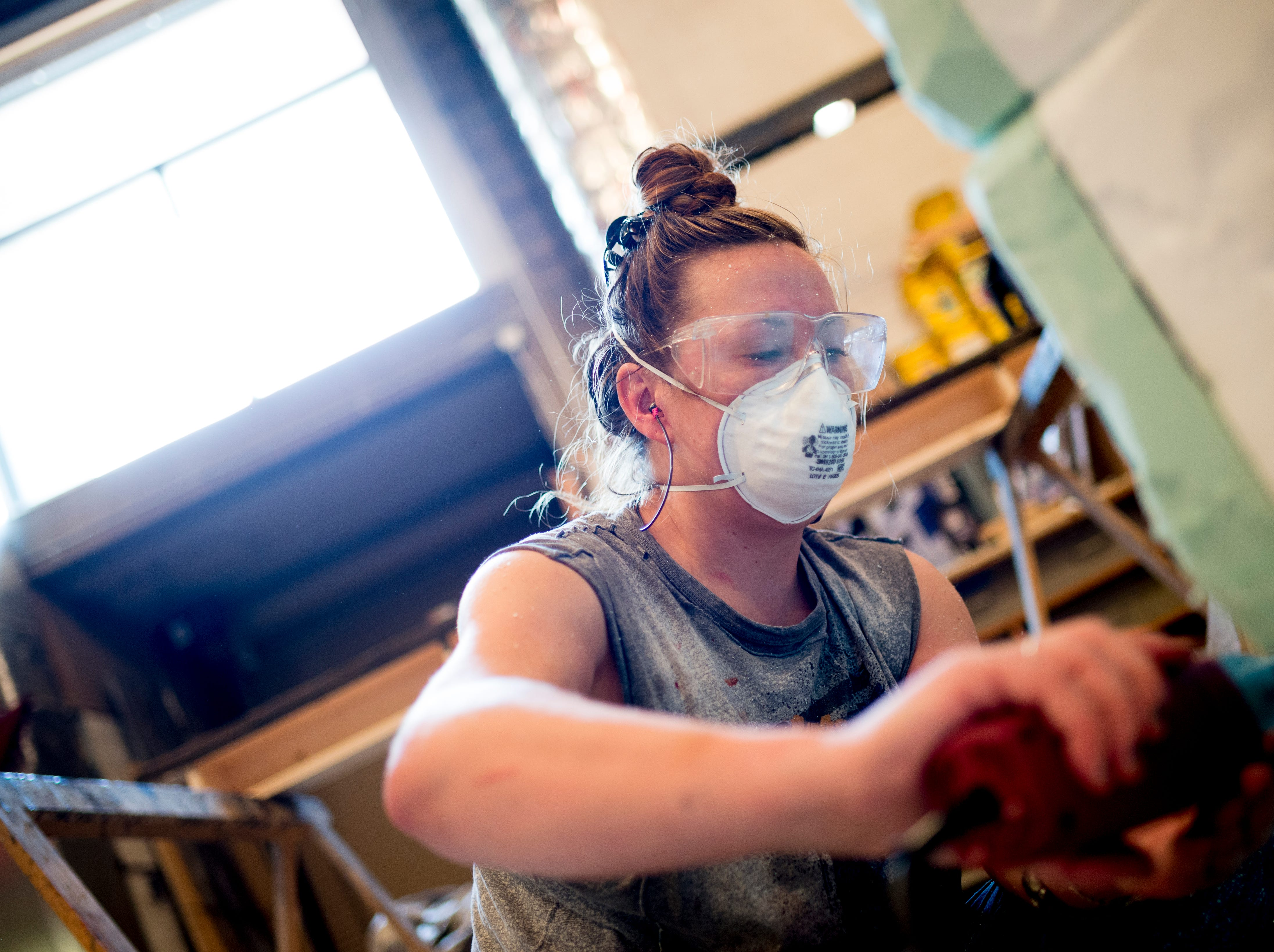 Katie Moseley works on crafting a stone chimney ahead of opening day for Candide at the Clarence Brown Theatre  in Knoxville, Tennessee on Tuesday, August 14, 2018. Leonard BernsteinÕs acclaimed operetta, Candide, is to open Friday, August 31, with previews beginning August 29.