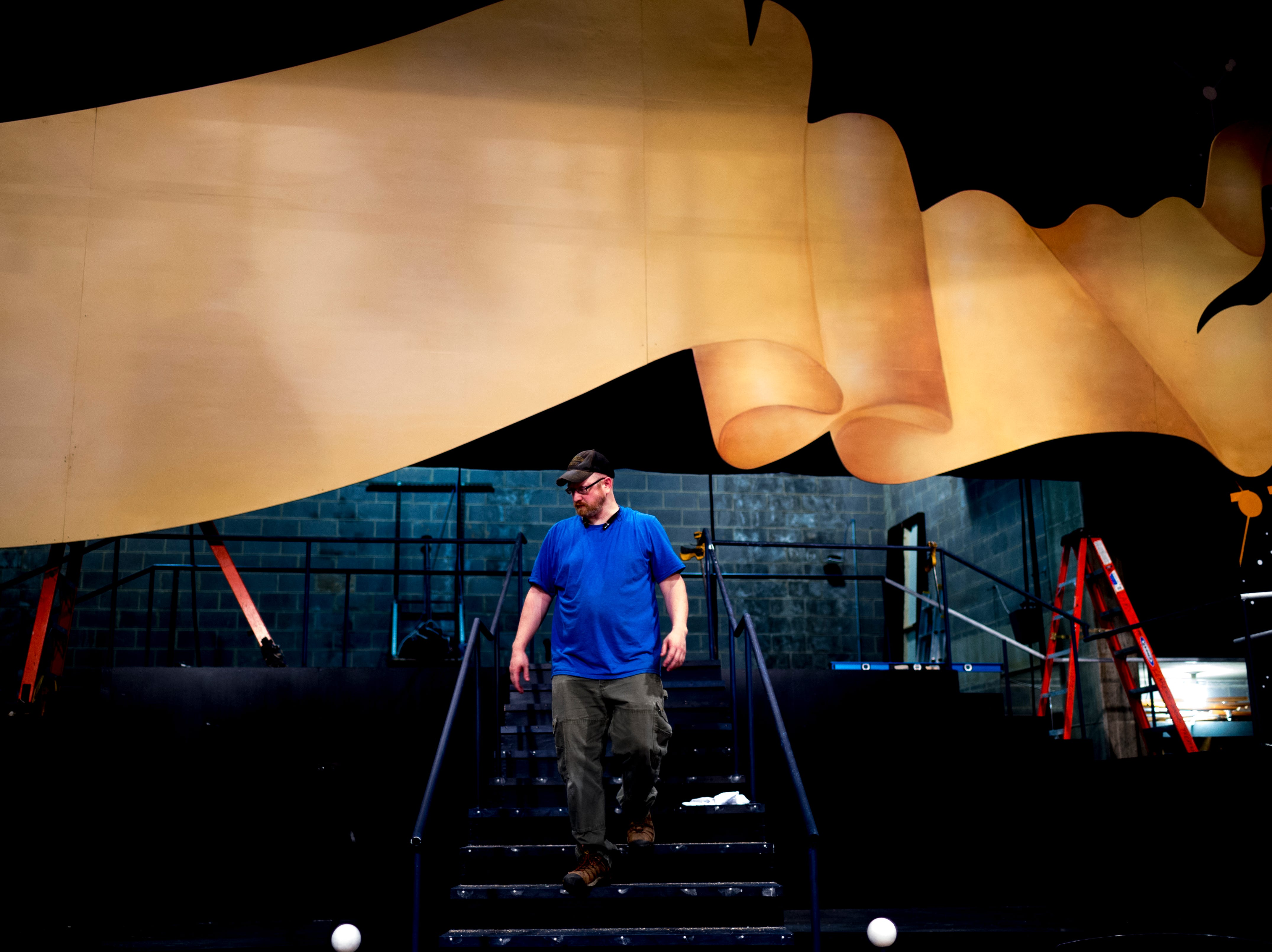 A stage crew worker walks on the stage ahead of opening day for Candide at the Clarence Brown Theatre  in Knoxville, Tennessee on Tuesday, August 14, 2018. Leonard BernsteinÕs acclaimed operetta, Candide, is to open Friday, August 31, with previews beginning August 29.