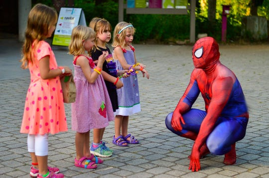 Spider-Man visits with children before a Spider-Man double feature at Ijams Nature Center, July 2017.