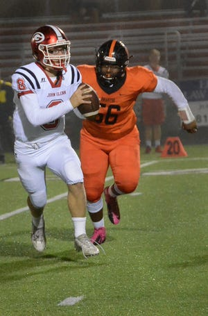 Colby Ford (56) provides a strong pass rush for Brighton.