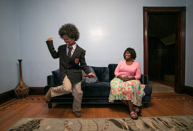 Andrés Rodriguez dances in happiness as his stepmother Toya Rodriguez watches before his first day of school at the new W.E.B. DuBois Academy in Louisville Wednesday morning. The 11-year-old was excited about his uniform as well as making friends at the all-boy academy.
