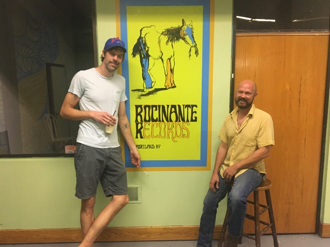 Danny Seim, left, poses with Mickey Ball in the new Rocinante Records.