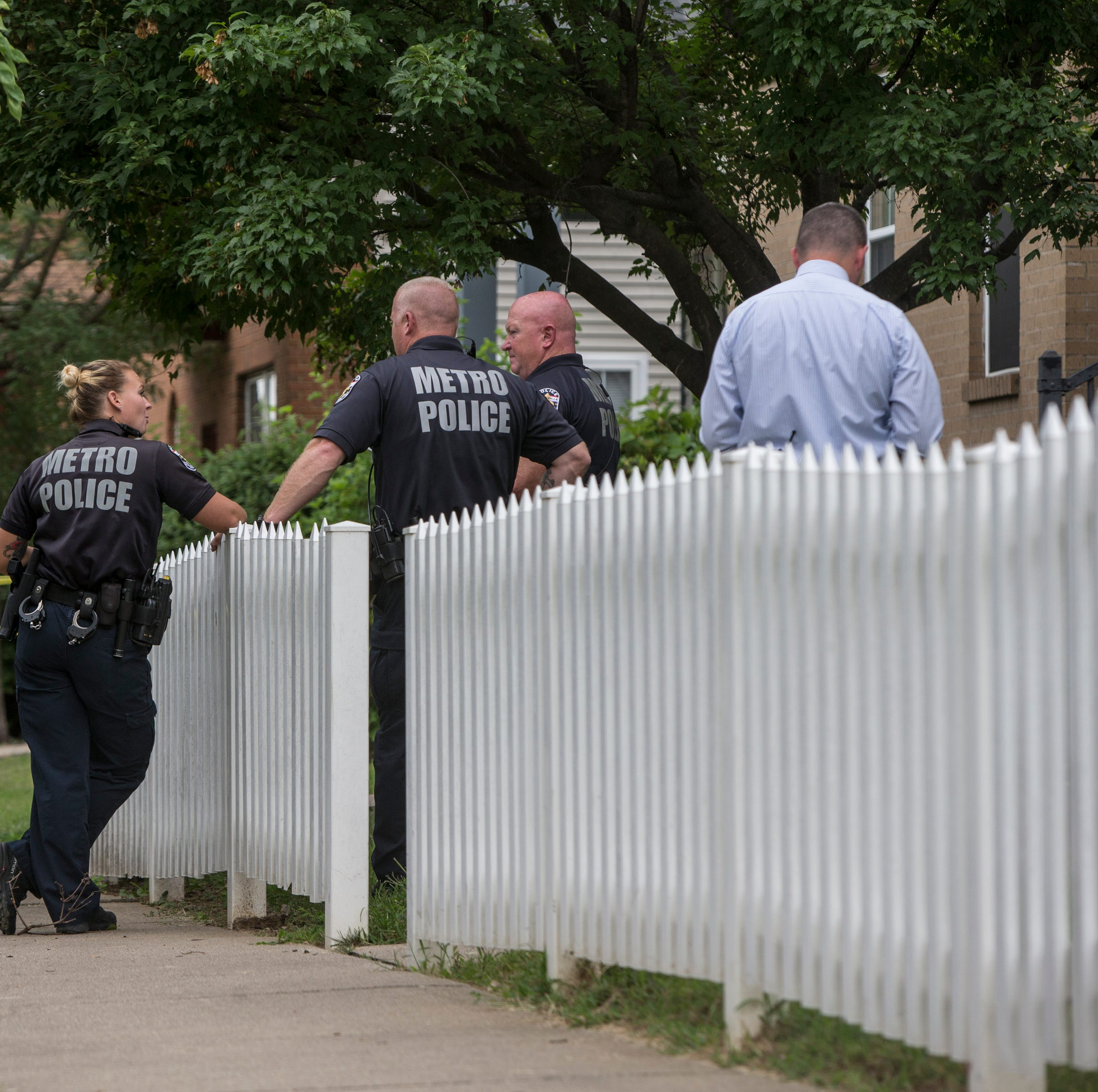Louisville Metro Police officers talk at the scene of a shooting of a two year old child in the 1700 black of 32nd Street. Aug. 15, 2018.