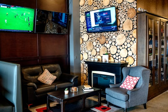 A cozy seating area near the bar at Cask & Company restaurant and bar on Tuesday, Aug. 14, 2018, in Lansing. The business, formerly Xiao, has gone under a complete renovation including the addition of 30 60-inch TVs for the sports bar crowd.