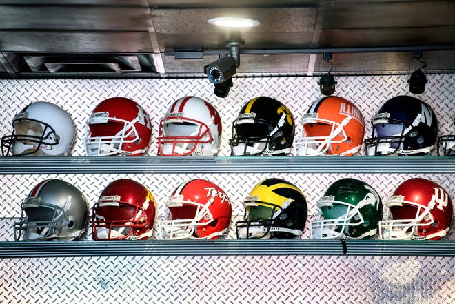 Football helmets from the Big Ten at Front 43 bar photographed on Tuesday, Aug. 14, 2018, in Lansing.