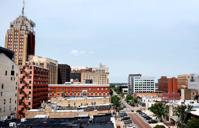 A composite of two images looking north at downtown Lansing from the top of the Knapp's Centre on Washington Square photographed on Wednesday, Aug. 15, 2018.
