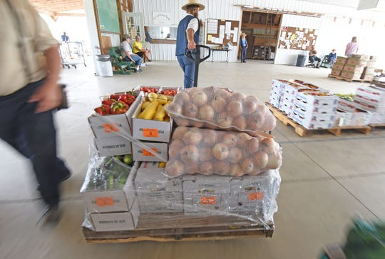 Truckloads of food are sold Wednesday morning at the Owl Creek Produce Auction in Morrow County.