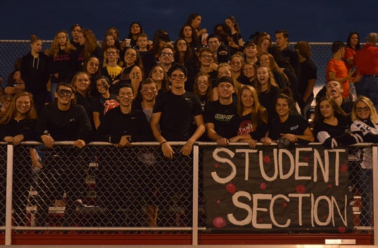The Elgin student section supports the football team during a game last season. This will be the second year the Comets play in the Northwest Central Conference.