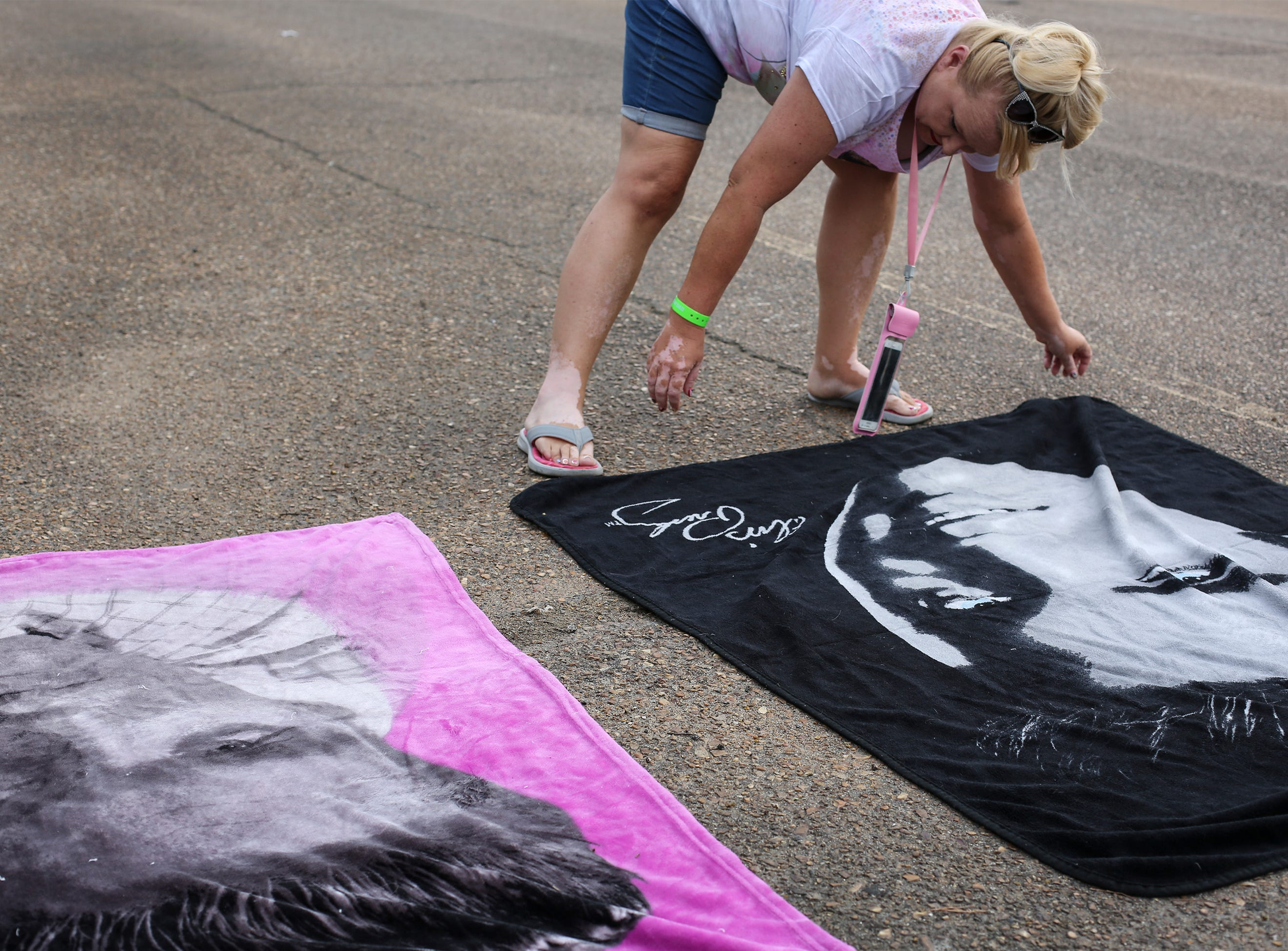 """Elvis Presley fan Donna Galloway of Long Beach, Miss., setup blankets before a candlelight vigil during """"Elvis Week"""" that marks the 41st anniversary of Presley's Aug. 16 death."""