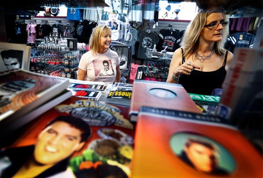 Boulevard Souvenirs owner Renae Roberts (left) chats with costumer Beth Salomie, (right) from Altoona, P., at her store a half block north of the gates of Graceland. Roberts owns the the last independent souvenir shops near Graceland.