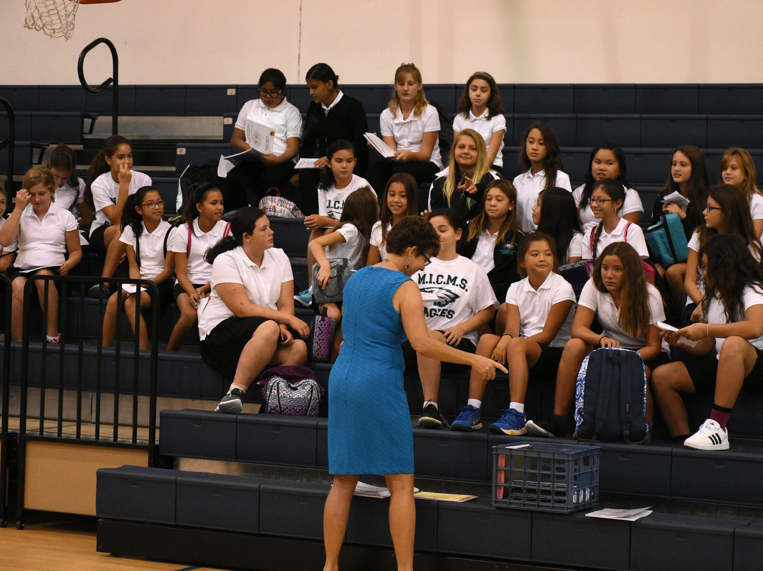 Phys. Ed. teacher helps orient students in the gym at Marco Island Charter Middle School. Marco Island students, along with all of Collier County, returned to school for the first day of classes in the new school year on Wednesday.