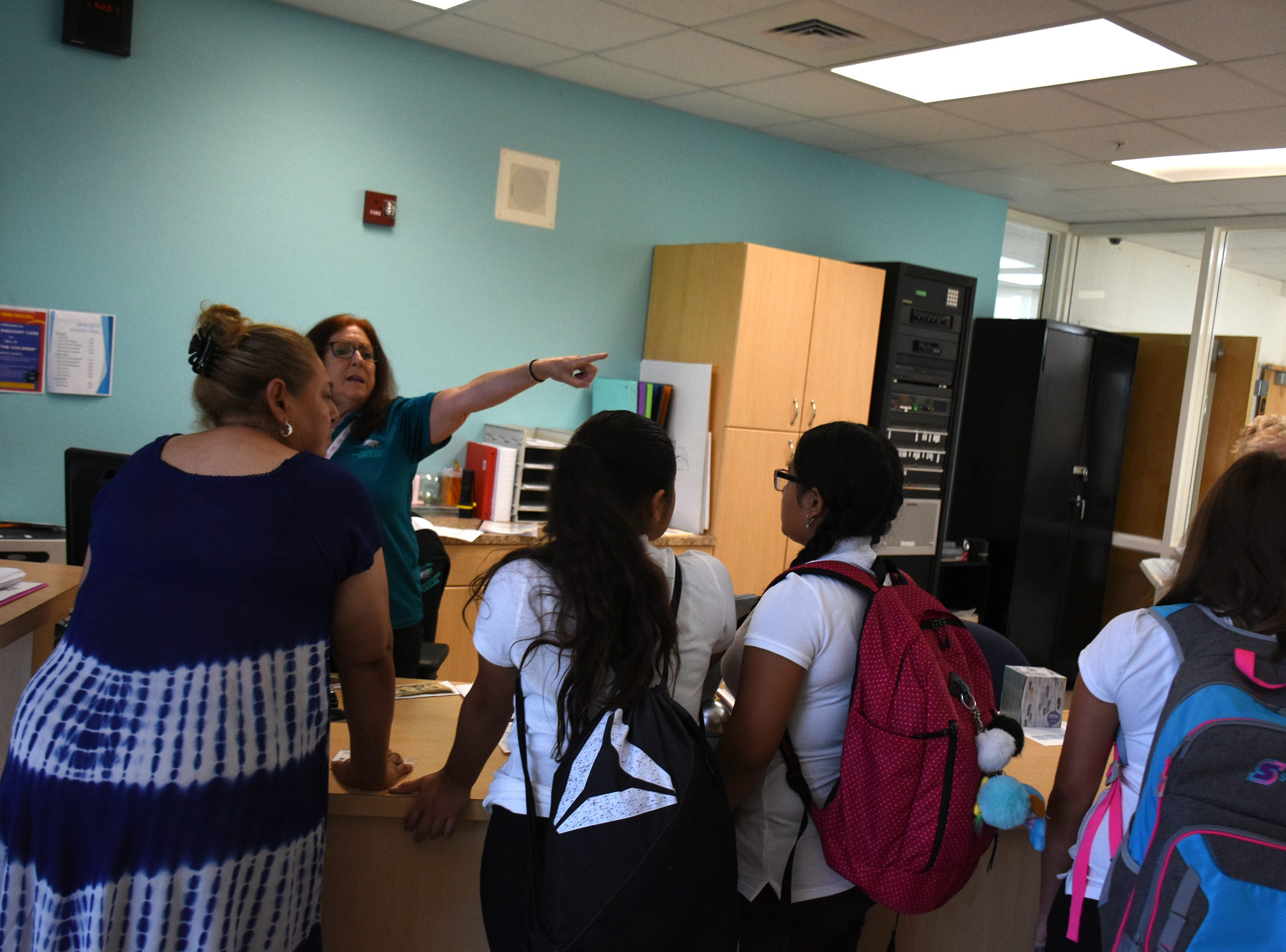 School secretary Rona Donato directs students on the first day at Marco Island Charter Middle School. Marco Island students, along with all of Collier County, returned to school for the first day of classes in the new school year on Wednesday.