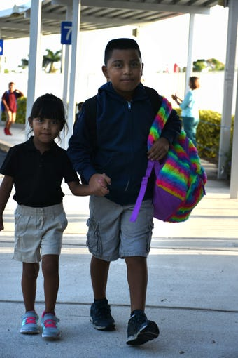 Fourth grader Edwin Perez lends a hand to little sister Lorita, entering kindergarten. Marco Island students, along with all of Collier County, returned to school for the first day of classes in the new school year on Wednesday.