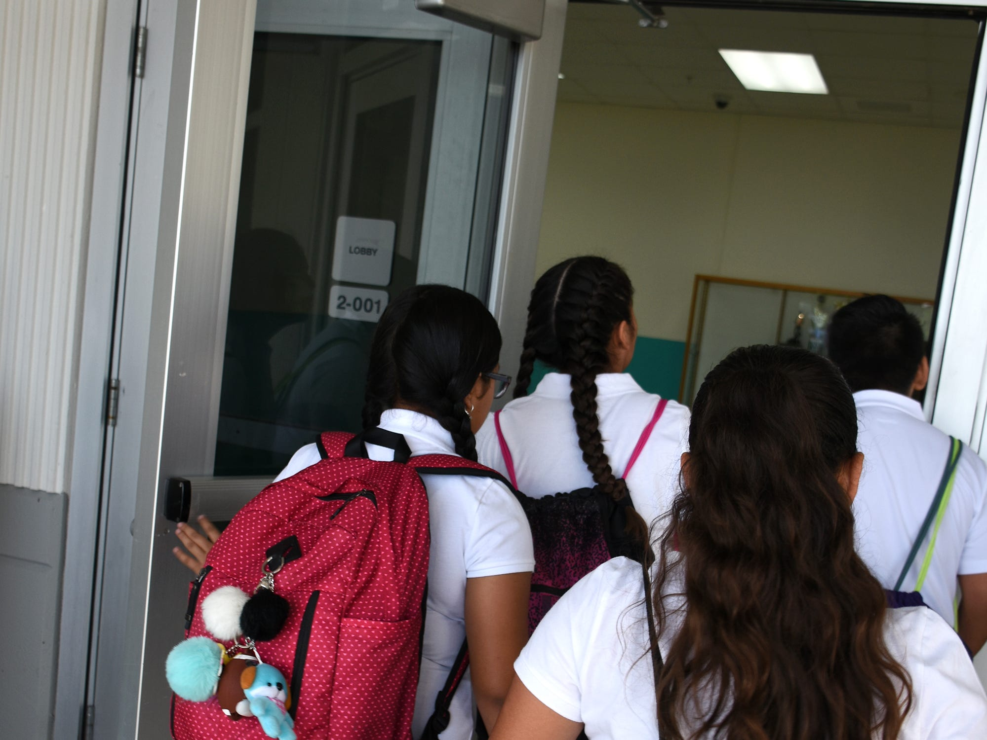 Students stream into school at Marco Island Charter Middle School. Marco Island students, along with all of Collier County, returned to school for the first day of classes in the new school year on Wednesday.