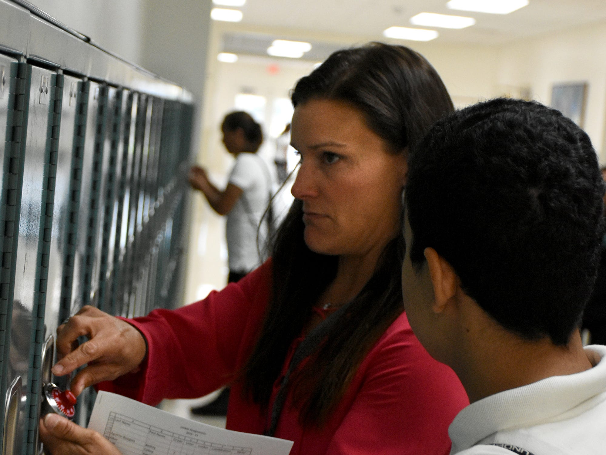 Science teacher Carrie Doxsee assists a student with his locker. School secretary Rona Donato directs students on the first day at Marco Island Charter Middle School. Marco Island students, along with all of Collier County, returned to school for the first day of classes in the new school year on Wednesday.
