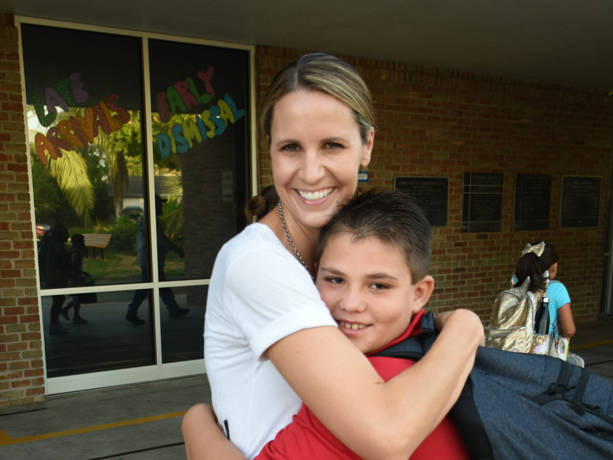 Tommie Barfield Elementary principal Katie Maya gets a hug from returning student Dillon. Marco Island students, along with all of Collier County, returned to school for the first day of classes in the new school year on Wednesday.