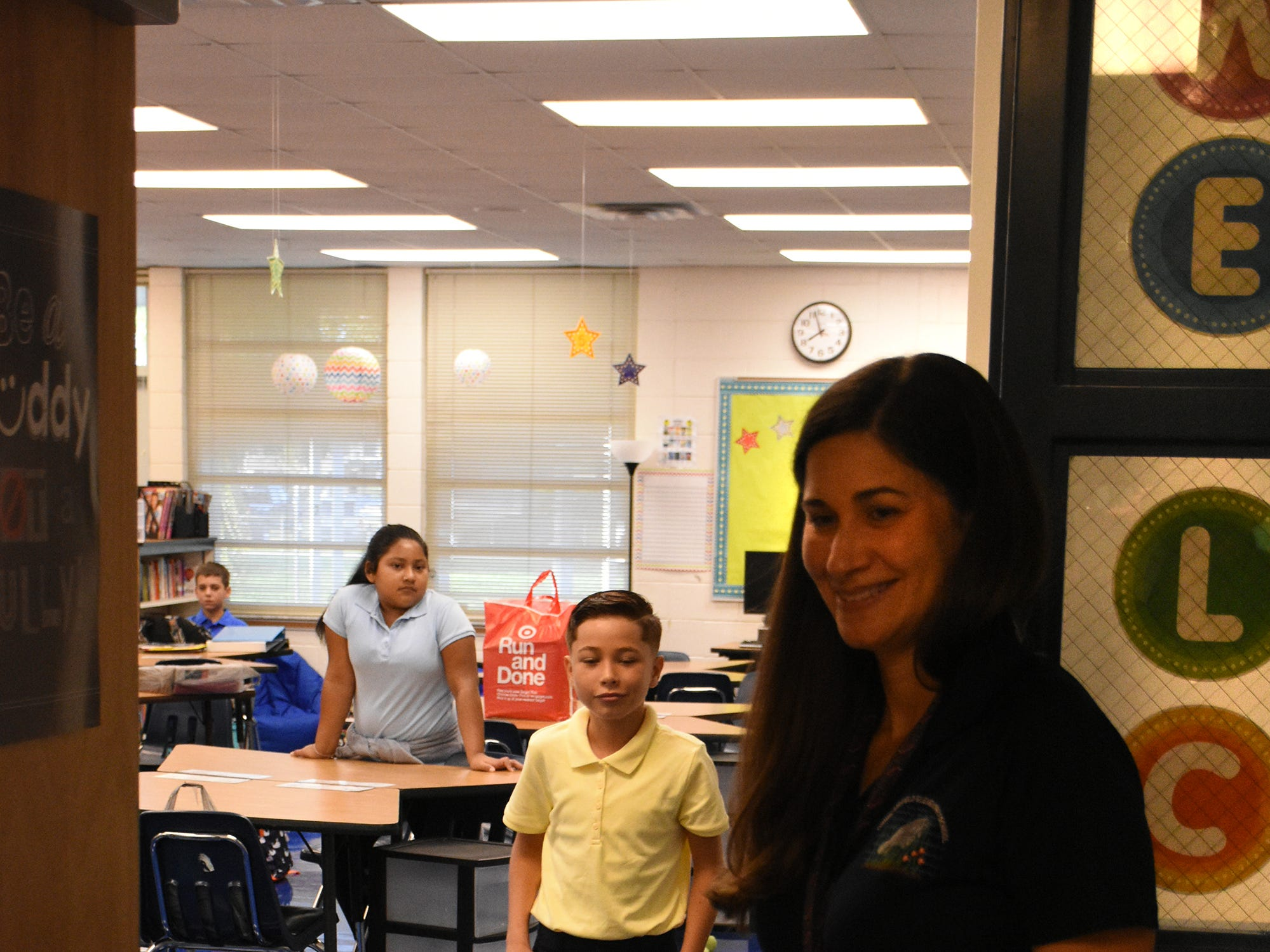 Fifth grade teacher Marilyn Morales welcomes her new class at TBE. Marco Island students, along with all of Collier County, returned to school for the first day of classes in the new school year on Wednesday.