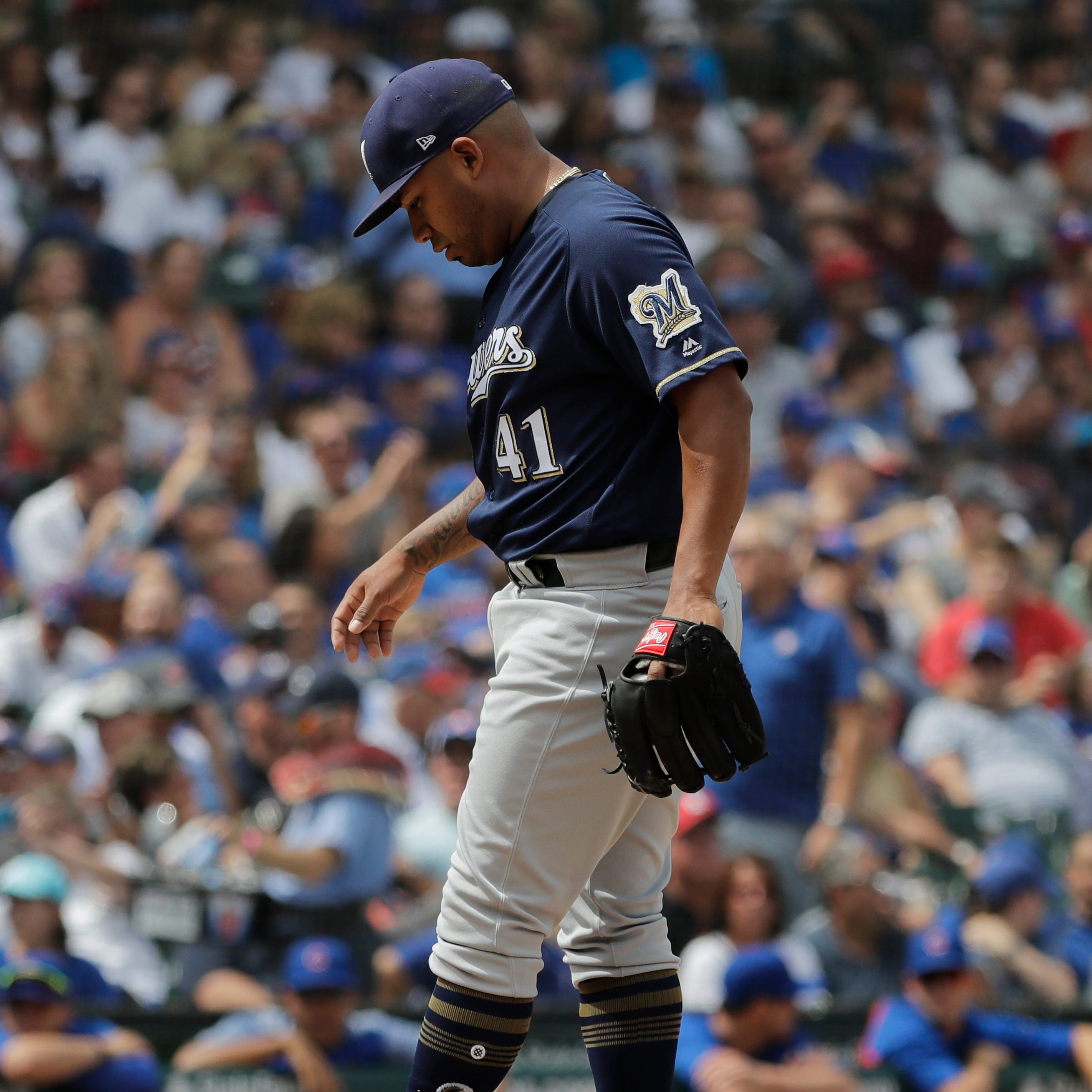 Milwaukee Brewers starting pitcher Junior Guerra kicks the mound during the third inning of a baseball game against the Chicago Cubs, Wednesday, Aug. 15, 2018, in Chicago. (AP Photo/Nam Y. Huh) ORG XMIT: OTKNH108