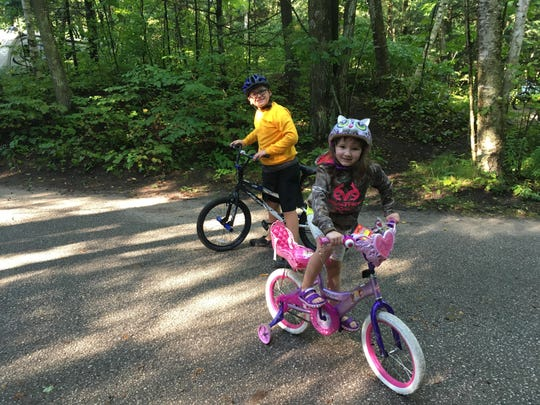 Whether you're camping at a family campground or a state park, it's a good idea to find a paved place for bike riding.