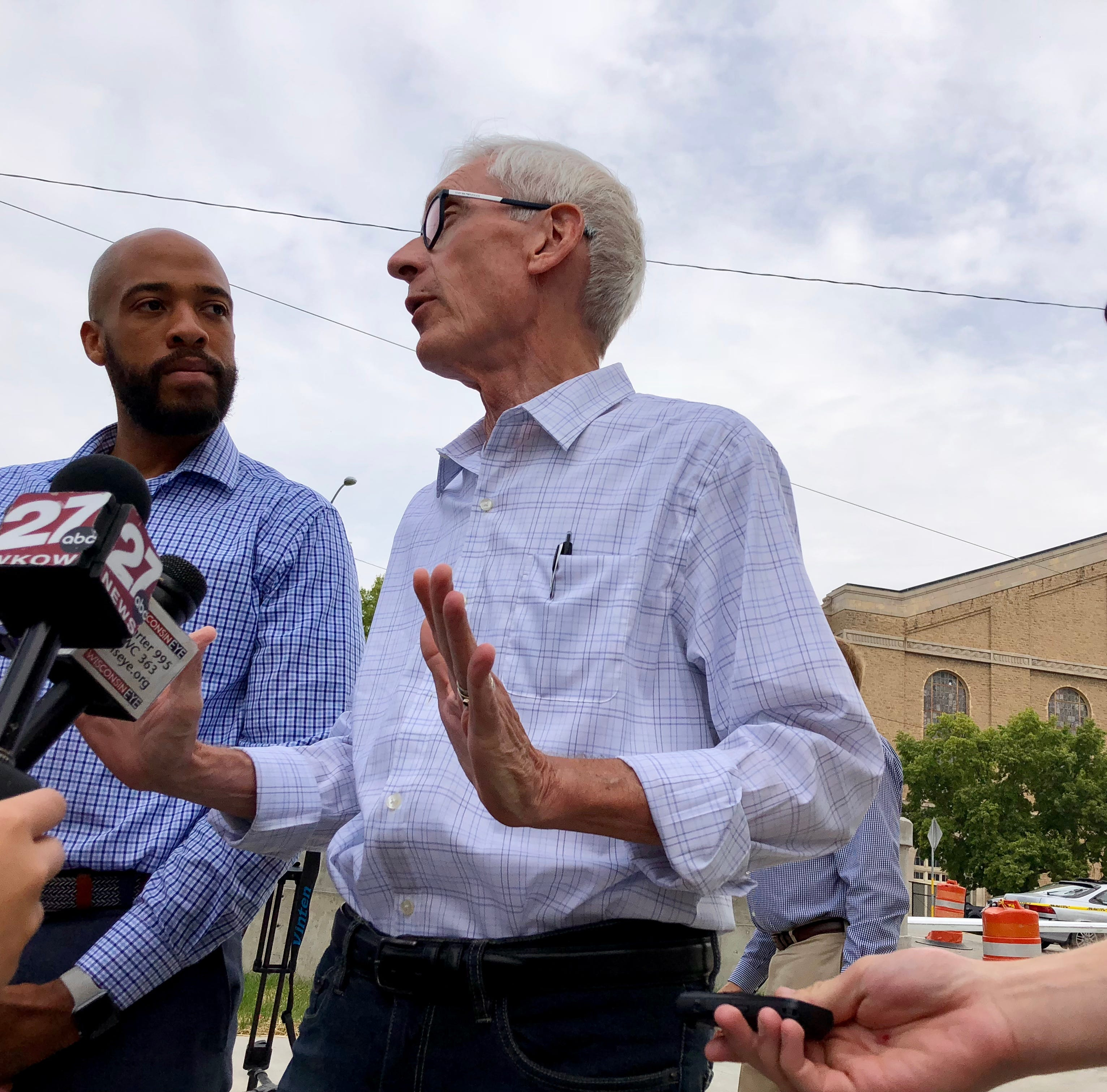 Scott Walker touts tax breaks as he and Tony Evers joust over road funding