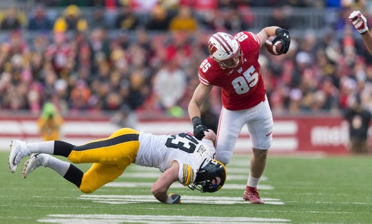 Wisconsin Badgers tight end Zander Neuville makes a move against Iowa linebacker Josey Jewell in a game last season.