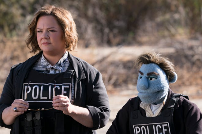 "Melissa McCarthy plays a human cop paired with a Muppet-ish detective to solve a string of puppet murders in the dark, crude comedy ""The Happytime Murders."""