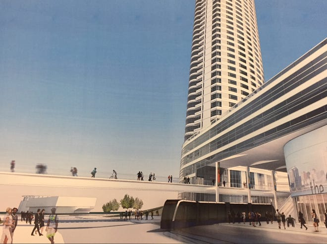 The new East-West Bus Rapid Transit service will use the transit concourse at The Couture apartment high-rise.