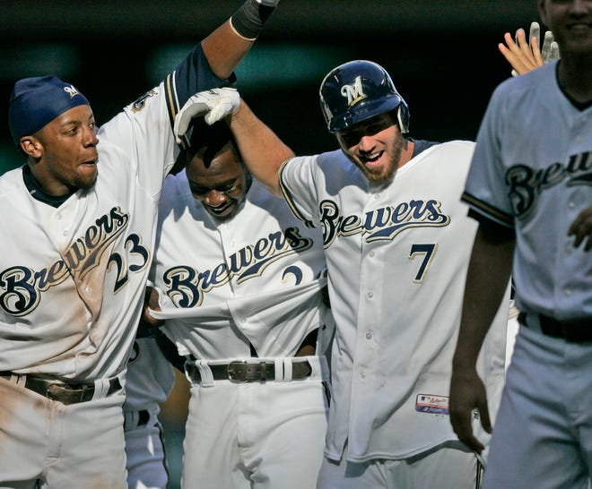 Brewers shortstop JJ Hardy gets mobbed by his teammates after getting the game winning RBI in the 12th inning Aug. 24 against Pittsburgh -- one of two walk-off wins in August of 2008.