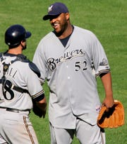CC Sabathia (52) celebrates with catcher Jason Kendall after a one-hitter against Pittsburgh on Aug. 31, 2008.