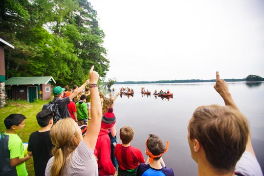 Campers and canoeists are photographed along the shore of Camp Manito-wish YMCA in Boulder Junction.