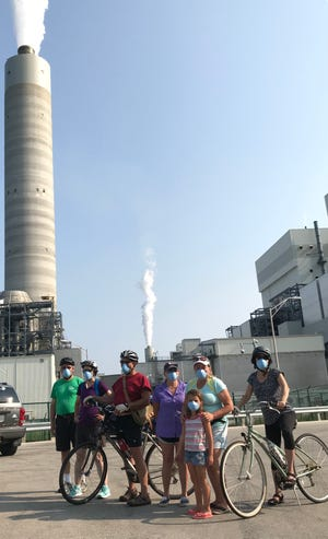 About 35 people attended the bicycle ride put on by the Clean Power Coalition and the Sierra Club on Aug. 11 which was designed to show participants the We Energies plant (specifically the coal pile) which has been affecting residents on the north side of the plant with dust.