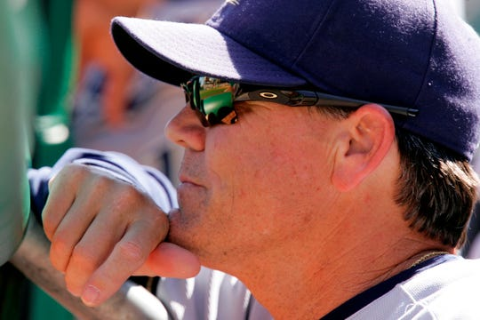 Milwaukee Brewers manager Ned Yost watches from the dugout during a 7-0 win over the Pittsburgh Pirates in a baseball game in Pittsburgh, Sunday, Aug. 31, 2008.