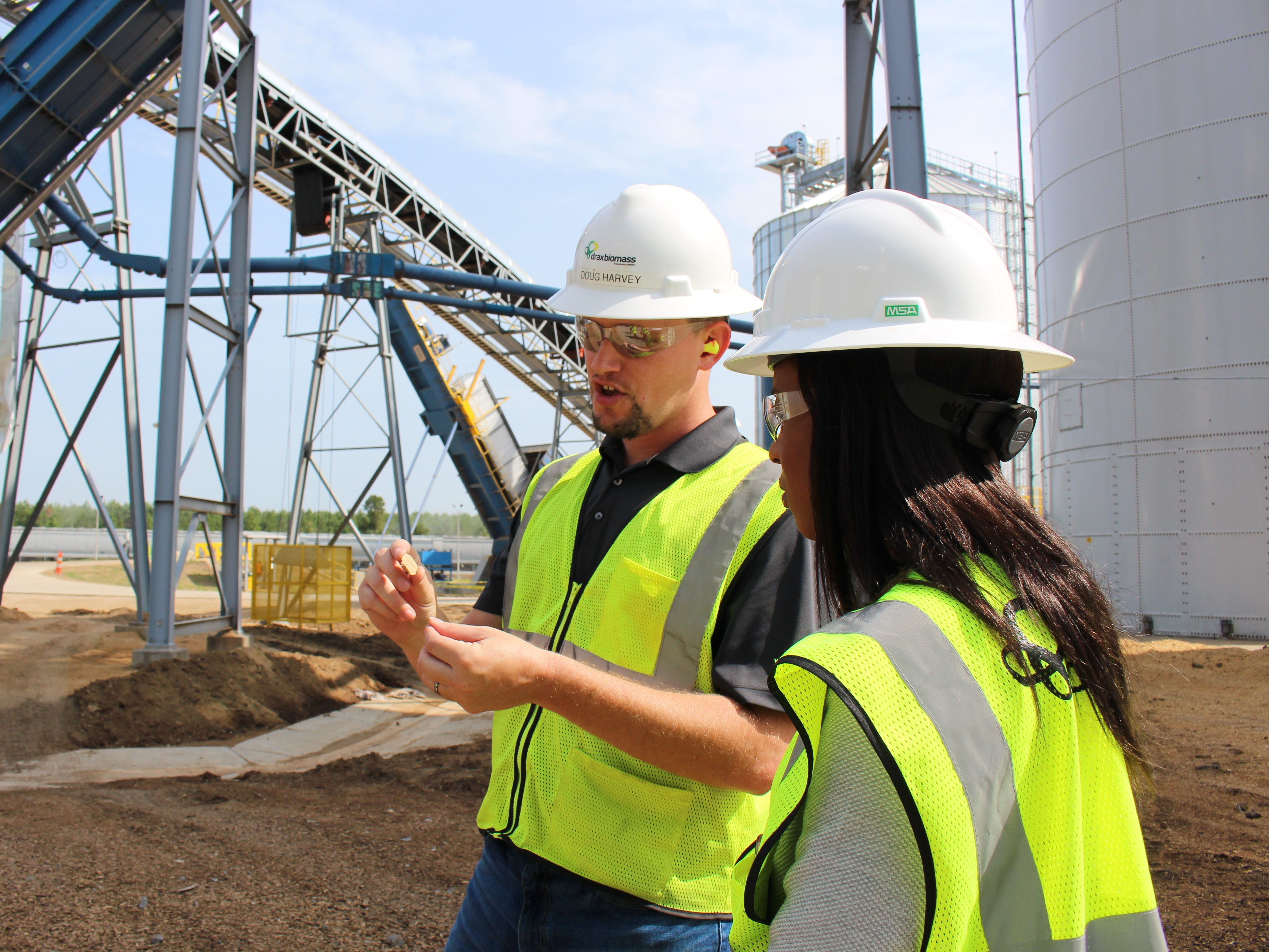 Drax Biomass converts pine timber and sawmill residual fiber into biomass pellets that are used to generate power in the United Kingdom. Plant manager at Morehouse Bioenergy Doug Harvey is seen showing wood material after it moves through a hammermill to KTVE/KARD Reporter Rae'Ven Jackson.