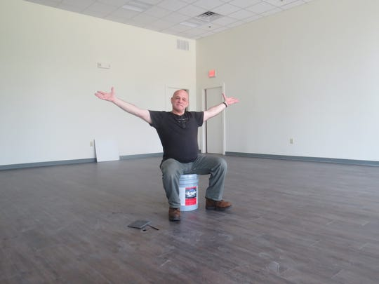 John Pietrowski, artistic director of Madison's professional Writer's Theatre of New Jersey, shows off the new multipurpose space at the new mixed-use Rose Hall development off Kings Road. Pietrowski will produce professional theater productions there while other Madison arts organizations will use the space for concerts, art exhibitions and more public events.