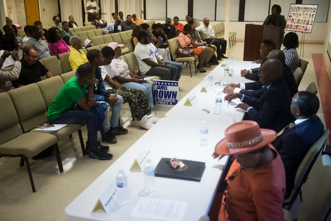 The crowd listens to candidates during a city council district 4 candidate forum in Montgomery, Ala., on Tuesday, Aug. 14, 2018.