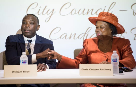 William Boyd and Doris Cooper Anthony greet each other during a city council district 4 candidate forum in Montgomery, Ala., on Tuesday, Aug. 14, 2018.