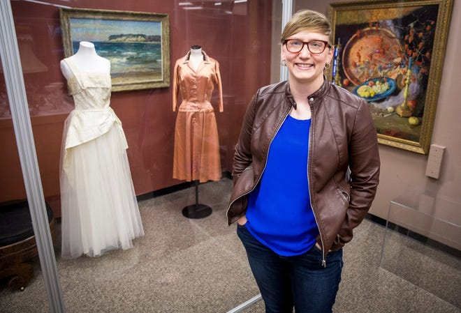 Jessica Jenkins, curator at Minnetrista, stands in the display room for the museums many artifacts. Jenkins has worked at Minnetrista for the past two years and has a passion for women's history.
