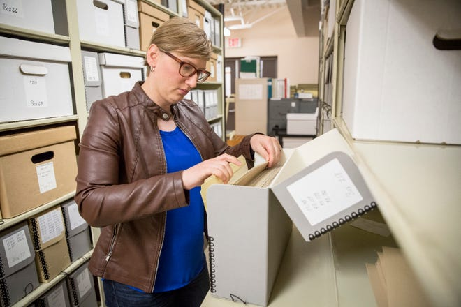 Jessica Jenkins, curator at Minnetrista, looks through files in the archives. Jenkins has worked at Minnetrista for the past two years and has a passion for women's history.
