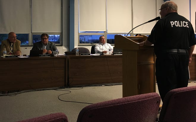 Security Chief Chuck Hensley addresses the Muncie Community Schools Board on Tuesday night.