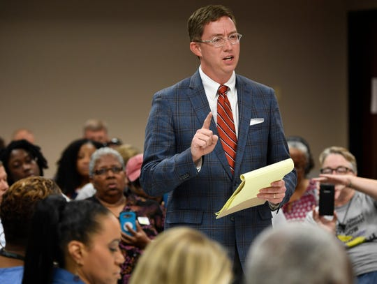 Austin McMullen, attorney for the Nashville Fraternal Order of Police, addresses the Davidson County Election Commission about the certification of a petition to put a community review board over the police department on the November general election ballot during the commission's meeting Wednesday, Aug. 15, 2018, in Nashville, Tenn.