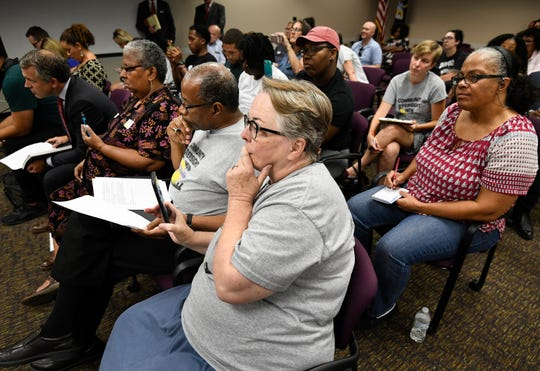 Members of Community Oversight Now listen during the Davidson County Election Commission meeting Wednesday, Aug. 15, 2018, in Nashville. The election commission voted 5-0 to verify 4,801petition signaturesto add a proposed Metro Charter amendment creating a police oversight board to the Nov. 6 ballot.