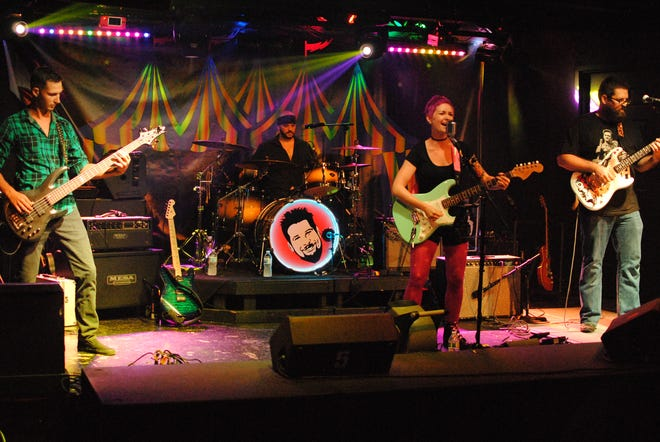 Kate Skales, on vocals, performs with her SWFL-based rock n' roll band at Buddha Rock Club in Fort Myers on Aug. 14, 2018.