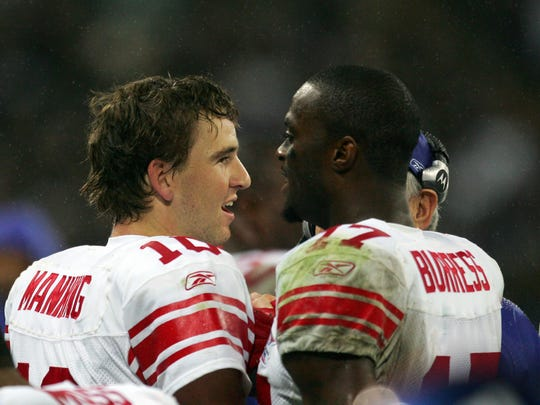 New York Giants qb Eli Manning, left, with Plaxico Burress on the sidelines during their game against the Miami Dolphins at Wembley Stadium, London, Sunday, Oct. 28, 2007. (AP Photo/Tom Hevezi)