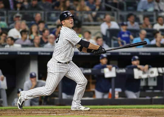 New York Yankees catcher Austin Romine (28) hits a two run home run in the fifth inning against the Tampa Bay Rays at Yankee Stadium.