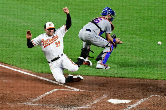 Baltimore Orioles third baseman Renato Nunez (39) scores on designated hitter Mark Trumbo (not pictured) sacrifice fly during the fourth inning against the New York Mets at Oriole Park at Camden Yards.
