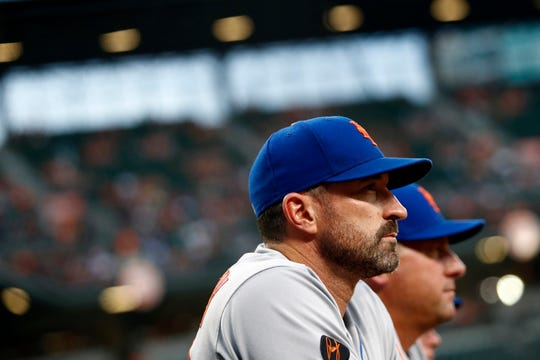 New York Mets manager Mickey Callaway stands in the dugout in the second inning of a baseball game against the Baltimore Orioles, Tuesday, Aug. 14, 2018, in Baltimore.