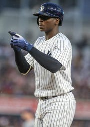 New York Yankees shortstop Didi Gregorius (18) reacts after hitting a single in the first inning against the Tampa Bay Rays at Yankee Stadium.
