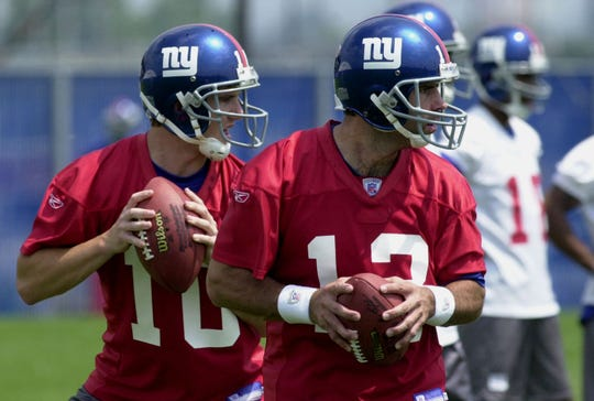 Quarterbacks Eli Manning, left, and Kurt Warner work out at the New York Giants minicamp Monday, June 7, 2004, in East Rutherford