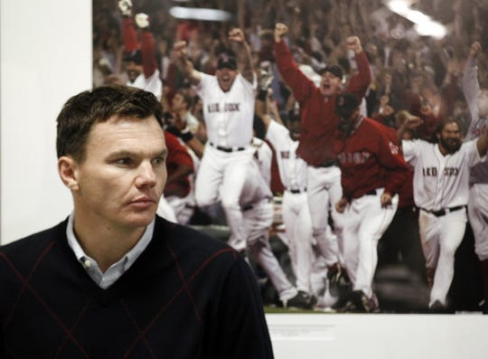 Boston Red Sox General Manager Ben Cherington listen to Philadelphia Phillies bench coach Pete Mackanin as he speaks with reporters after interviewing for the vacant Boston Red Sox manager position at Fenway Park in Boston Monday, Oct. 31, 2011.