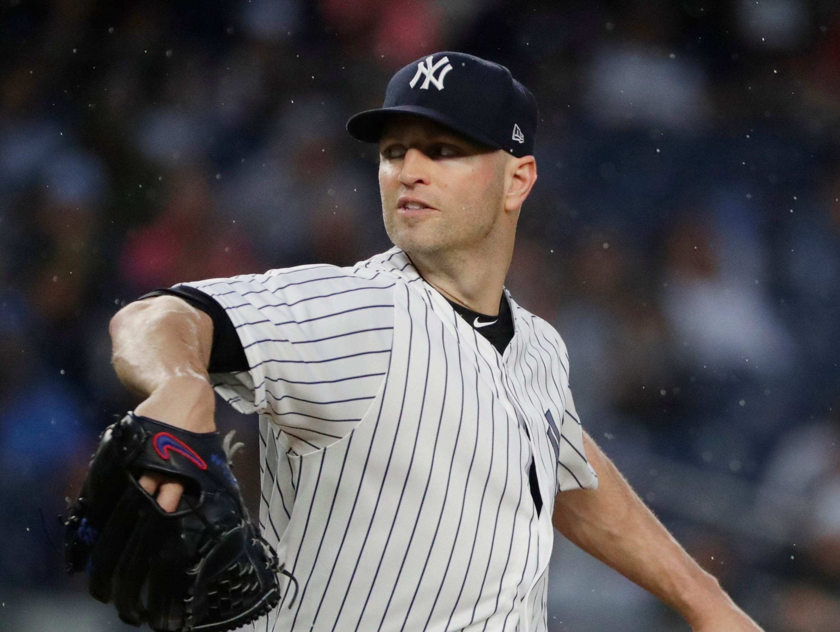 New York Yankees' J.A. Happ delivers a pitch during the first inning of a baseball game against the Tampa Bay Rays Tuesday, Aug. 14, 2018, in New York.